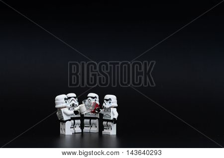 Orvieto Italy - November 15th 2015: Star Wars Lego Stormtroopers minifigures drunk a beer. Lego is a popular line of construction toys manufactured by the Lego Group
