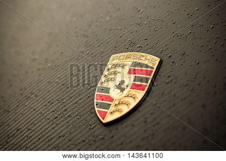 CSTUTTGART GERMANY - JUNE 08 2016: Close up logo of Porsche sign in Lucerne Switzerland on June 08 2016 Porsche founded the company in 1931.