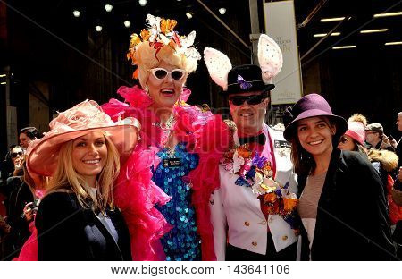 New York City - April 20 2014: Duchess Doris Dear (in pink feather boa) with friends at the Easter Parade on Fifth Avenue
