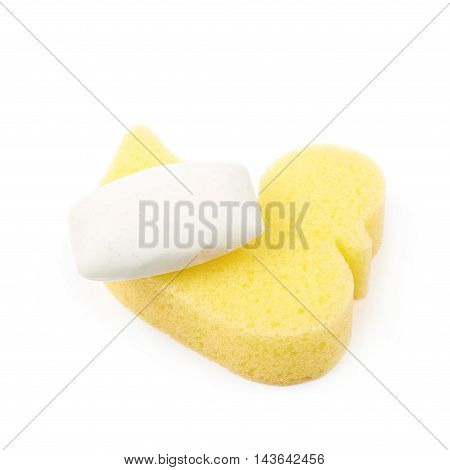 Yellow duck shaped bath sponge with a soap over it, composition isolated over the white background