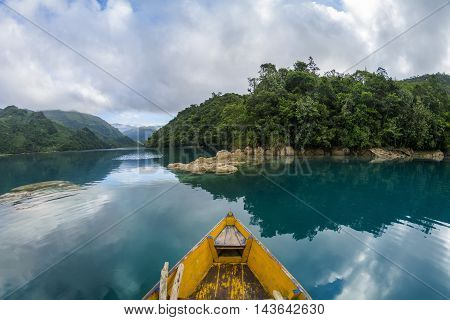 Guatemala Beauty with a view from a boat floating on the river