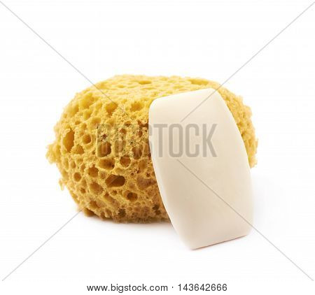 Round yellow bath sponge with a soap piece next to it, composition isolated over the white background