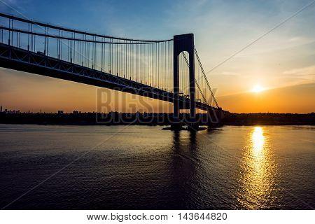 A sunrise view of the Verrazano Narrows Bridge in the New York Harbor.