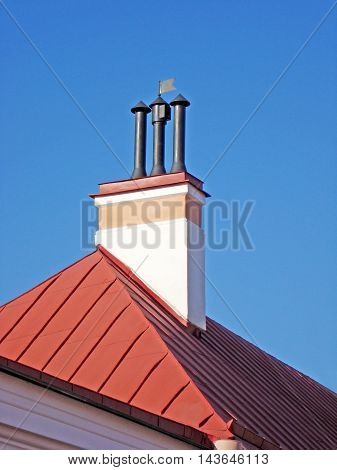 Roof with chimney and pipe. Fragment of house with smokestack.