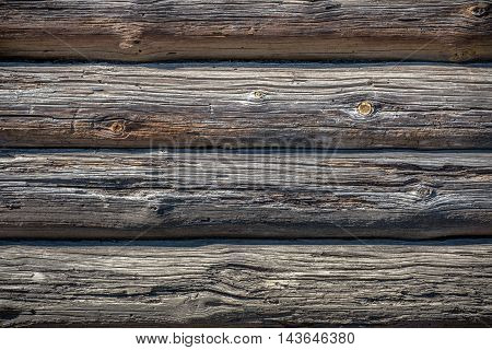wall of old pine logs lying horizontally