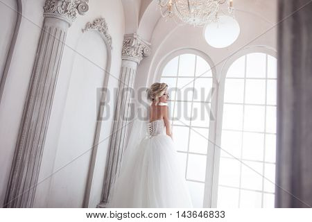 Charming young bride in luxurious wedding dress. Pretty girl in photo Studio, wedding photography