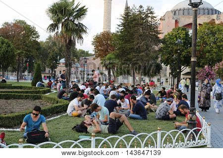 ISTANBUL TURKEY - JULY 27 2016: People play Pokemon go in Pokestop in front of Hagia Sophia. Pokemon go is location based augmented reality game developed by Niantic.
