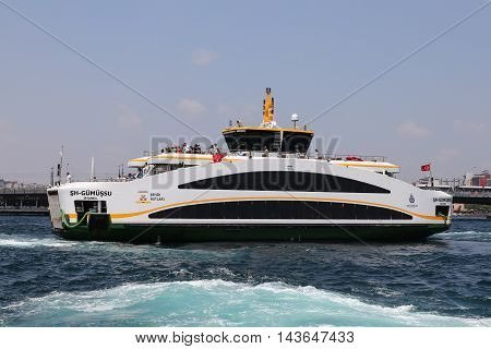 ISTANBUL TURKEY - JULY 28 2016: Sehir Hatlari ferry passing from European side to side Asian of Istanbul. Sehir Hatlari was established in 1844 and now carry 150000 passengers a day.