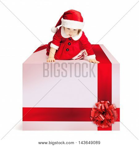 Christmas Gift Box and Baby in Santa Hat on White Background