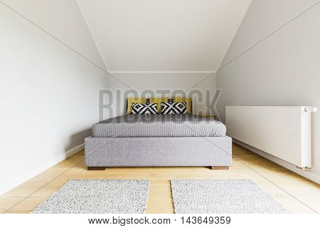 Elegance And Minimalism In An Attic Bedroom Decor