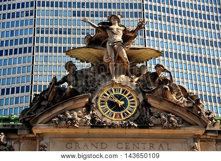 New York City - August 16 2013: The iconic beaux arts statue of the Greek God Mercury and gilded clock face adorn the south facade of Grand Central Terminal on East 42nd Street