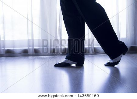 Black and white male dancing shoes. Posing.