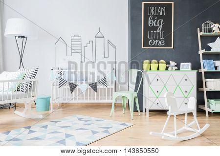 Modern design of comfortable spacious baby room