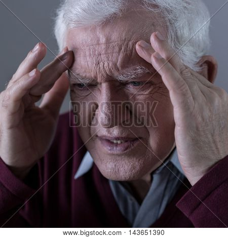 Man Holding His Head