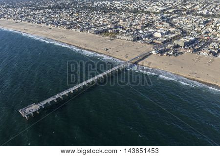 Hermosa Beach, California, USA - August 16, 2016:  Afternoon aerial view of Hermosa Beach pier, sand and sea near Los Angeles in southern California.