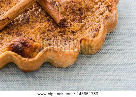 Sweet homemade pumpkin pie on blue background
