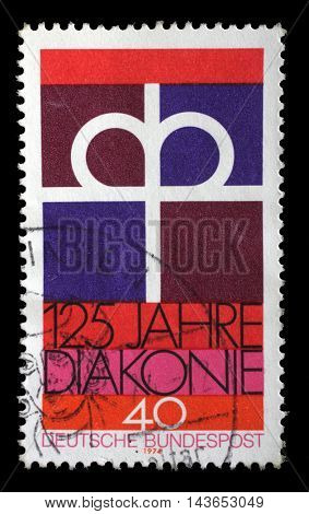 ZAGREB, CROATIA - JULY 03: A stamp printed in the Germany dedicated to 125th anniversary of the Diaconal Association of the German Protestant Church, circa 1974, on July 03, 2014, Zagreb, Croatia