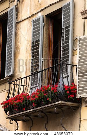 Ancient Italian architecture and colorfully decorative balcony in Florence Italy.