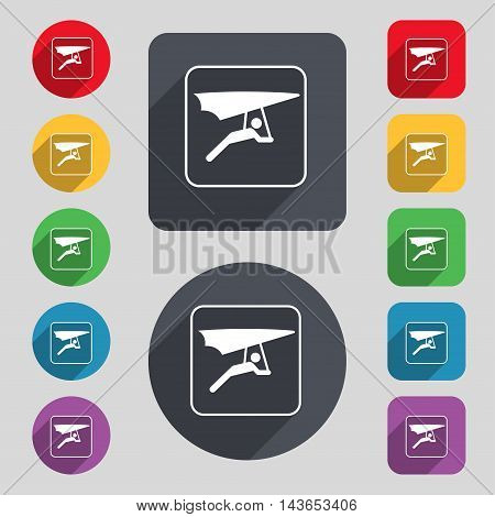 Hang-gliding Icon Sign. A Set Of 12 Colored Buttons And A Long Shadow. Flat Design. Vector