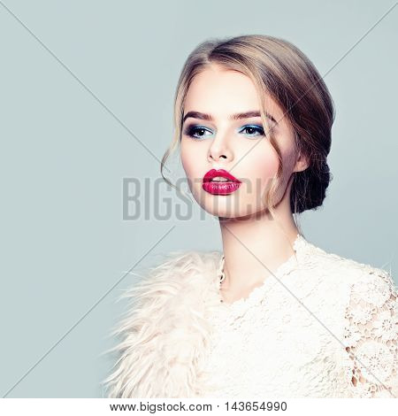 Blonde Fashion Model with red lips. Glamour Beauty