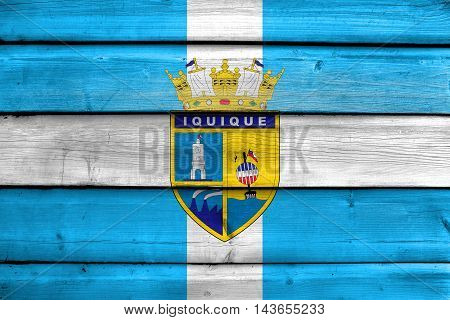 Flag Of Iquique, Chile, Painted On Old Wood Plank Background