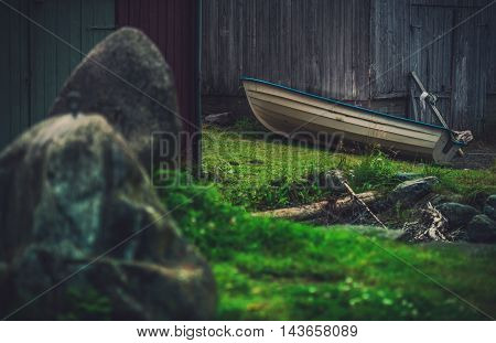 In the Norway Village. Theme with a Boat and the Wooden Barn. Norway Place.