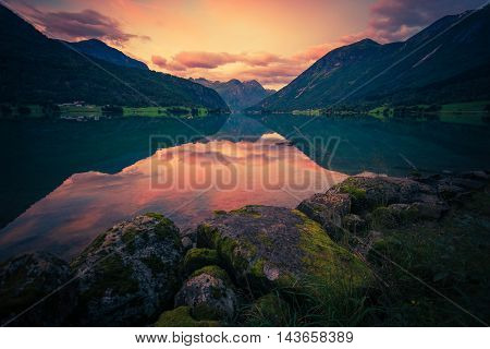 Norway Glacier Lake Sunset. Oppstrynsvatnet Norway Oppstryn Lake Reflections Scenery.