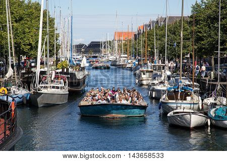 Copenhagen, Denmark - August 17, 2016: Tourist boats and sailboats in Christianshavn channel on a summer day