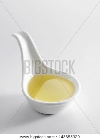spoon of the oil on the white background