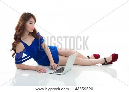 Woman with laptop isolated screen lying down on the floor