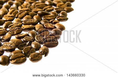 Many fresh brown coffee beans close up