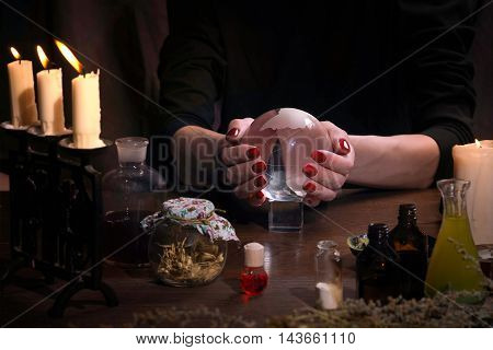 Hands Witch. Transparent Sphere. Magical Objects And Utensils Of The Alchemist. Candles, Herbs. Conc