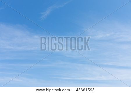 The photograph shows a sky with clouds