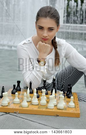 Girl Thought About The Chessboard.
