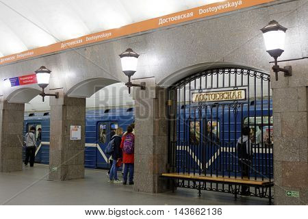 ST. PETERSBURG, RUSSIA - AUGUST 14, 2016: People in the metro station Dostoyevskaya. The station was opened in 1991 and is located at a depth of 62 m