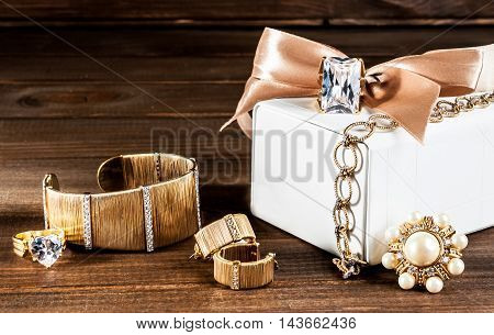 beautiful jewelry made of gold and precious stones rings bracelets earrings