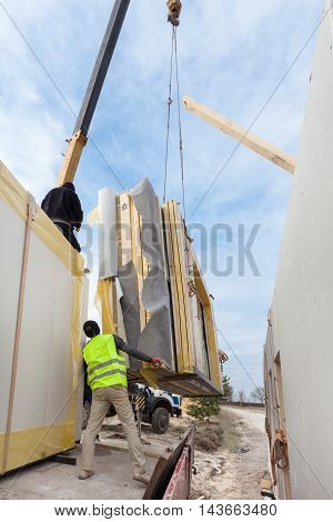 Builders Installing Frame House Structural Insulated SIP Panels. Building New Frame House