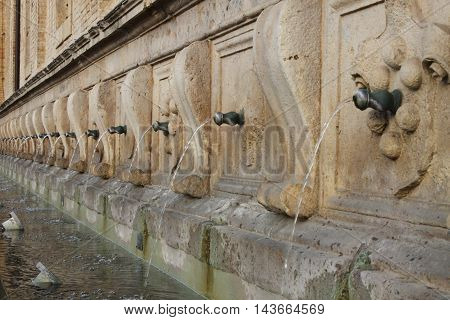 Medicean Fountains in Saint Mary of Angels Cathedral. Assisi Italy
