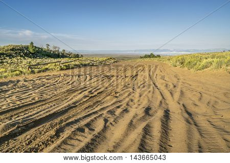 wide sandy road in North Sand Hills, only place in Colorado to  legally ride on sand dunes