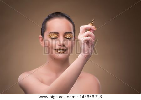 Woman with golden pen in fashion concept