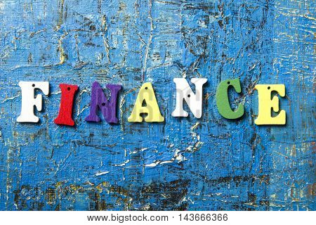 Wooden letters with the text Finance. Wood ABC.