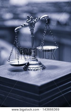 Symbol of law and justice in the empty courtroom law and justice concept. blue toned