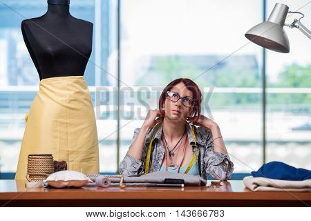 Woman tailor working at her desk