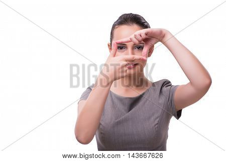 Young businesswoman holding hands in frame shape