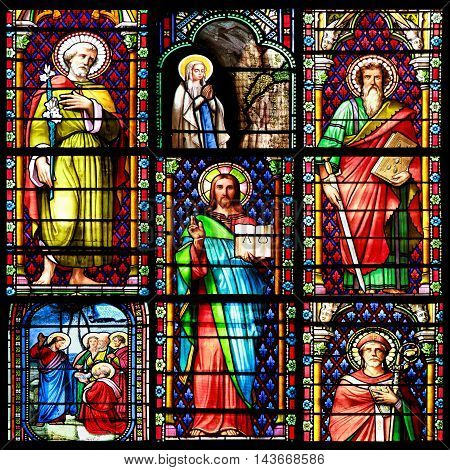 MEZE, FRANCE -July 23, 2014: Photo collage of Scenes of the Bible. Stained glass window in the Cathedral of Meze, on July 23, 2014 in Meze, south of France