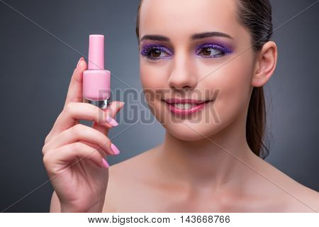 Young woman with lipstick in beaut concept