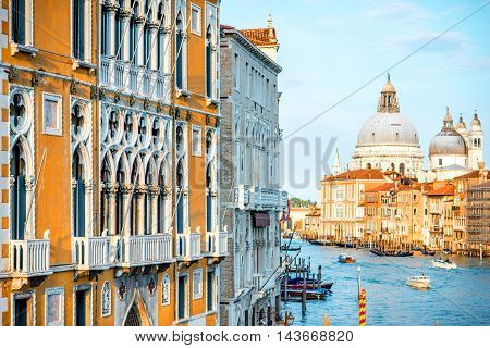 View on Grand canal with beautiful palace and Santa Maria basilica on the background from Accademic bridge in Venice