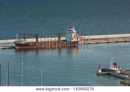 Alicante, Spain - SEPTEMBER 2015: Cargo ship in Harbor Terminal
