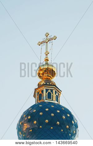 golden dome of the temple against the sky.
