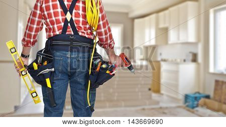 Electrician with drill and cable.